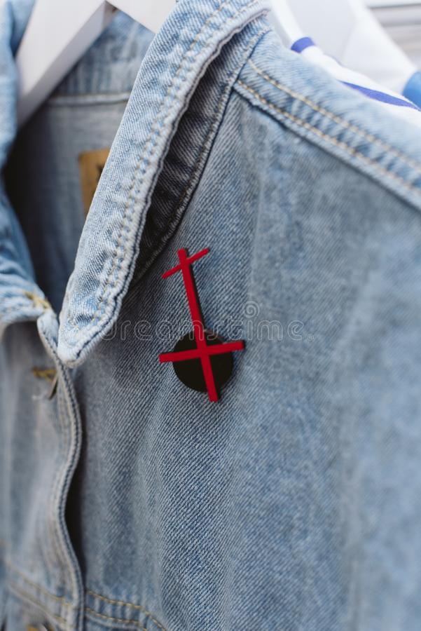 Denim style. Icon on clothes stock photos