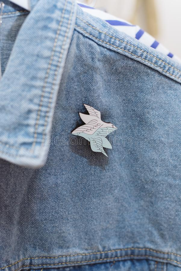 Denim style. Icon on clothes. Brooch on jeans. Denim style. Icon on clothes royalty free stock image