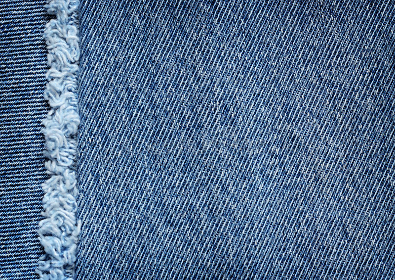 Denim texture with fringe. Blue denim texture with fringe dor background royalty free stock photography