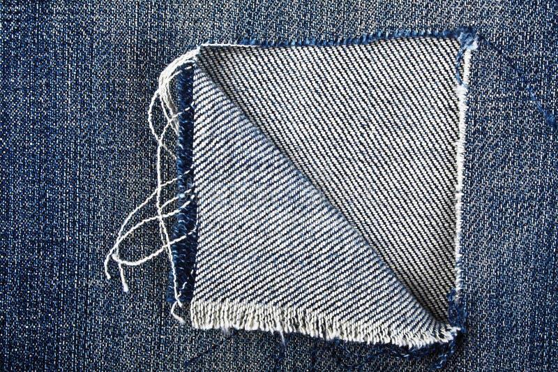 Denim texture, torn fabric stock images