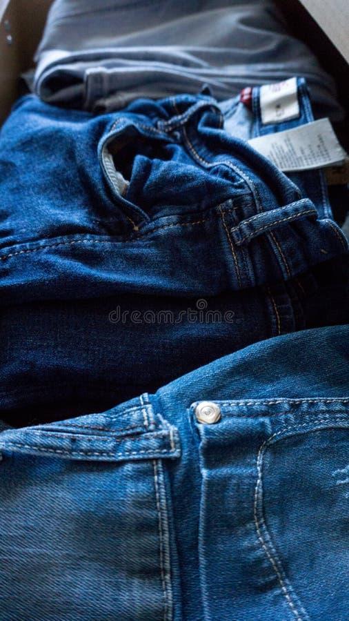 Denim trousers jeans pants drawer folded. Denim trousers pants drawer folded stock photography