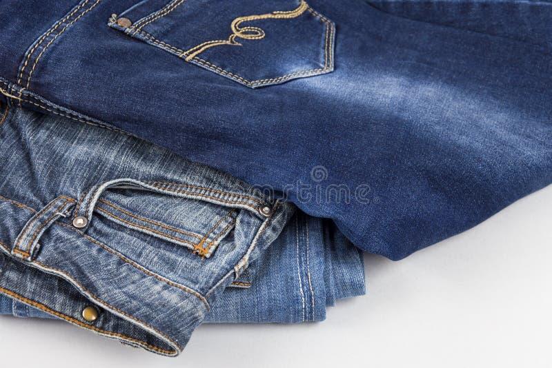 Denimachtergrond, denim met een naad van modieus ontwerp kleding broeken stock afbeeldingen