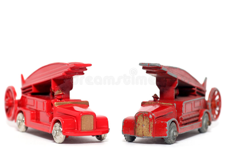 Denis samochodów ogień silnika nowej stara zabawka kontra fotografia royalty free
