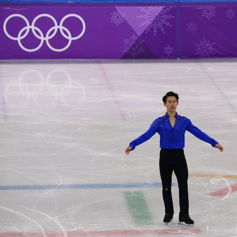 Denis Ten de Cazaquistão executa no único programa curto de patinagem dos homens nos 2018 Jogos Olímpicos do inverno imagem de stock