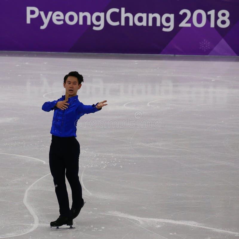 Denis Ten de Cazaquistão executa no único programa curto de patinagem dos homens nos 2018 Jogos Olímpicos do inverno fotografia de stock