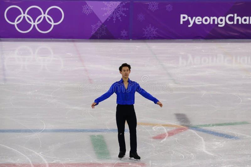 Denis Ten de Cazaquistão executa no único programa curto de patinagem dos homens nos 2018 Jogos Olímpicos do inverno foto de stock