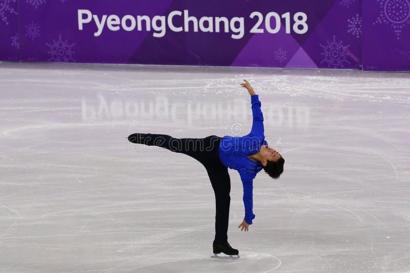 Denis Ten de Kazajistán se realiza en solo programa corto patinador de hombres en los juegos 2018 de olimpiada de invierno imagen de archivo libre de regalías
