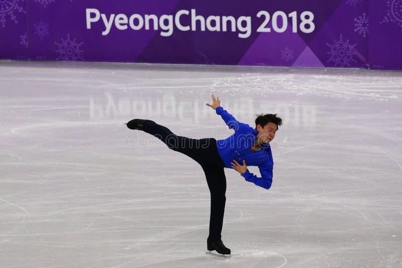 Denis Ten de Kazajistán se realiza en solo programa corto patinador de hombres en los juegos 2018 de olimpiada de invierno foto de archivo libre de regalías