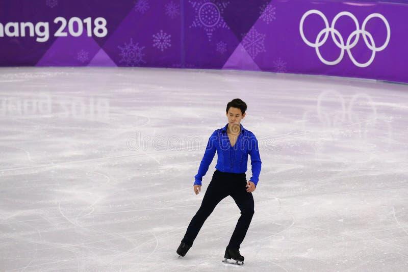 Denis Ten de Kazajistán se realiza en solo programa corto patinador de hombres en los juegos 2018 de olimpiada de invierno fotografía de archivo
