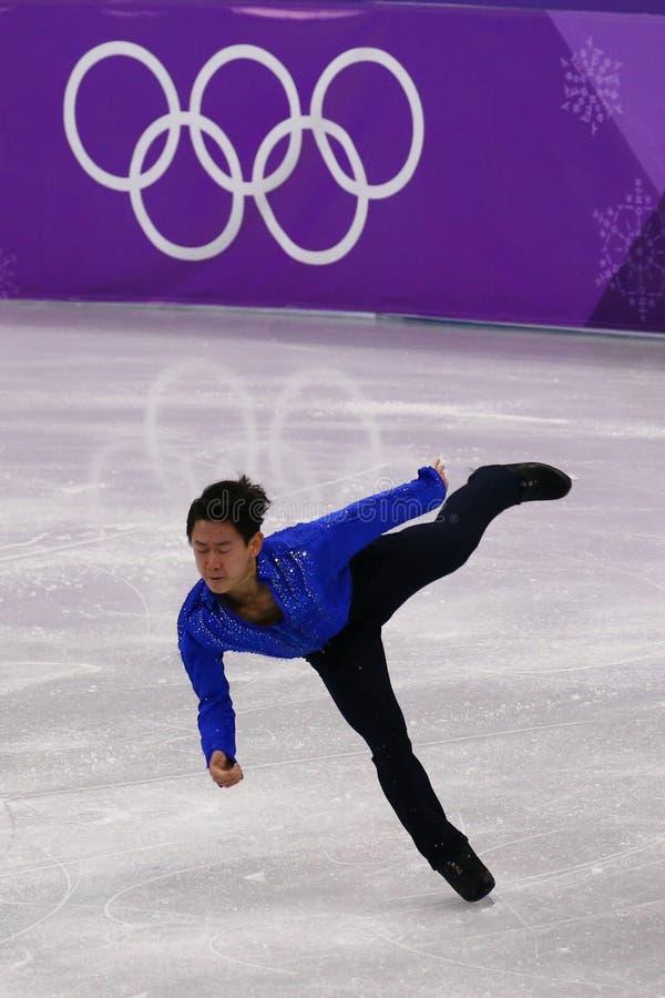 Denis Ten van Kazachstan voert bij Mensen Enig het Schaatsen Kort Programma uit bij de 2018 de Winterolympische spelen stock afbeelding