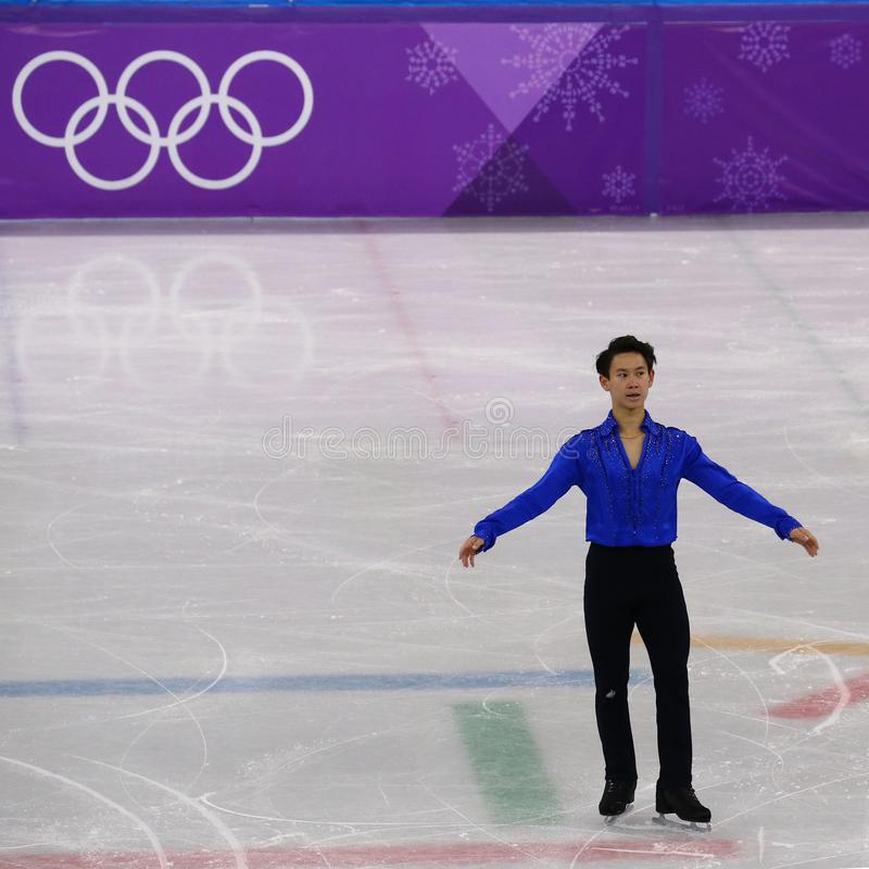 Denis Ten von Kasachstan führt in Männer-Einzel-eislaufendem kurzem Programm an der 2018 Winterolympiade durch stockbild