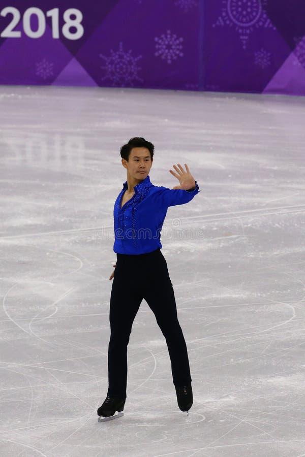 Denis Ten von Kasachstan führt in Männer-Einzel-eislaufendem kurzem Programm an der 2018 Winterolympiade durch lizenzfreies stockbild