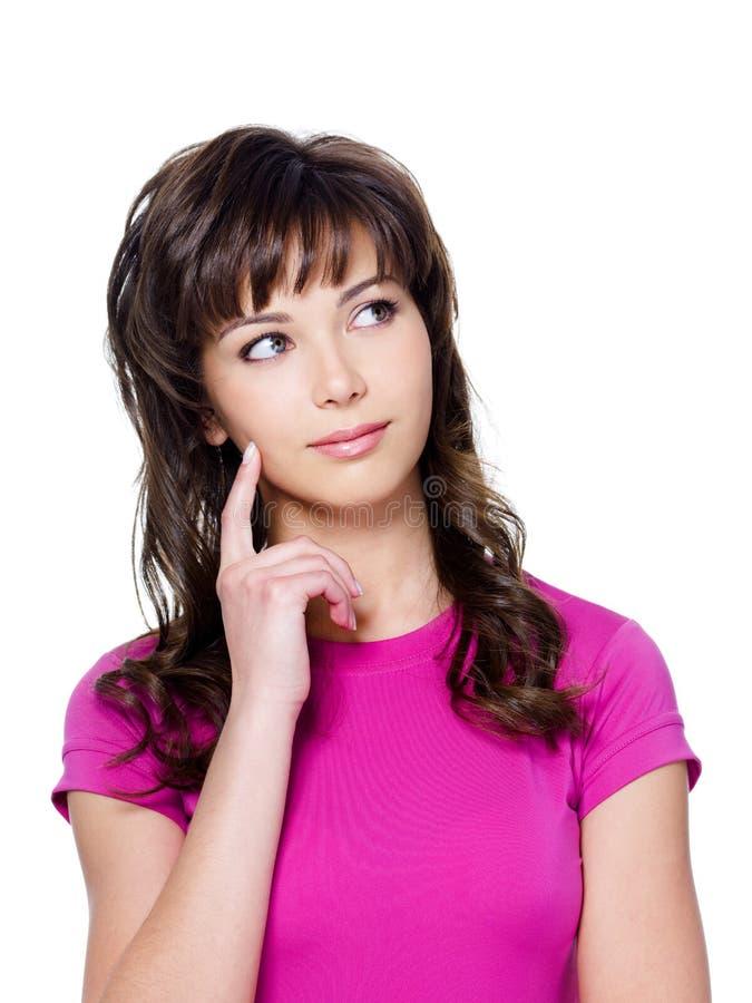 Denkende jonge vrouw met mooi gezicht stock afbeeldingen