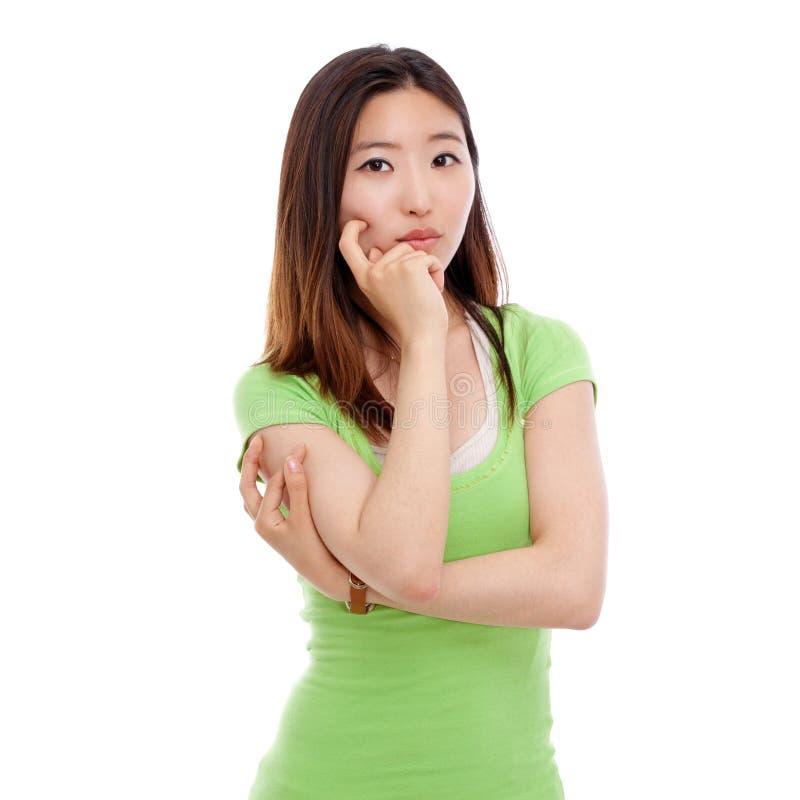 Denkende junge Frau stockfoto