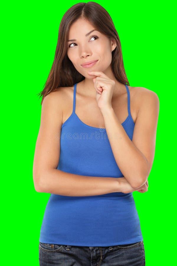Denkende junge Frau stockfotografie
