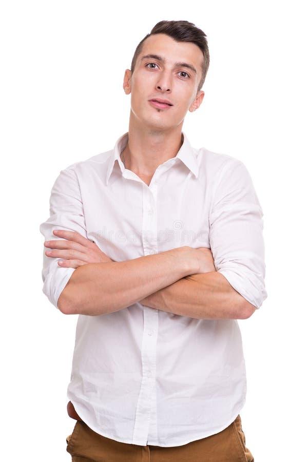 Denkende mens die op witte achtergrond wordt geïsoleerde Close-upportret van een toevallige jonge peinzende zakenman stock foto