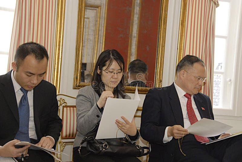 DENMARK_Chinese delegates. COPENHAGEN /DENMARK- Chinese Ambassador Li Luiyu and Chinese delegates at Royal Yellow Palae at National press briefing at Royal court stock photography