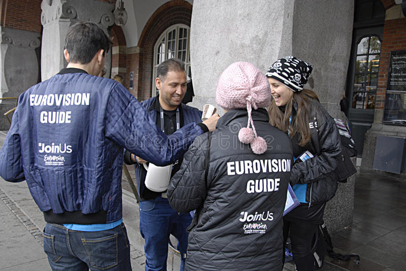DENMARK_EUROVISION 2014. COPENHAGEN /DENMARK- Travelers and valunteers worker for eurovision not paidn workers and not allow to see real finanl show on 11 may royalty free stock image