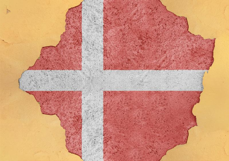 Denmark flag in big concrete cracked hole and broken material facade. Structure royalty free stock photography