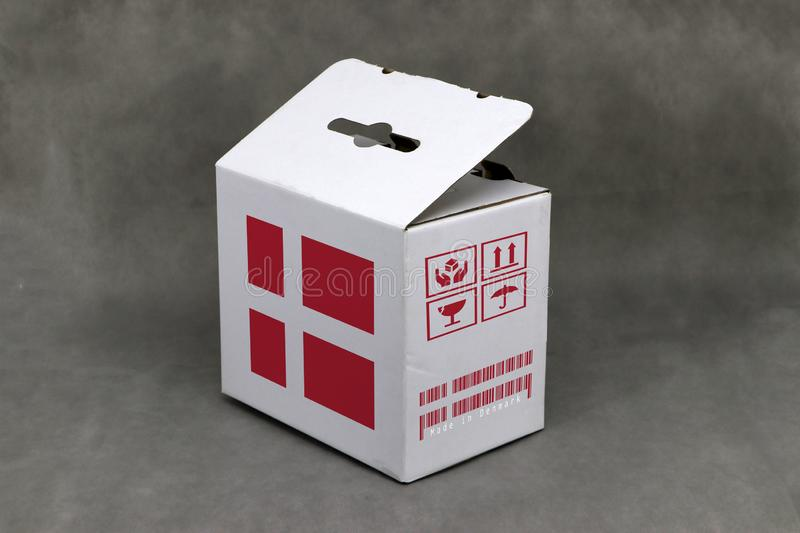Denmark flag on white box and nation flag barcode with fragile symbol. The concept of export trading from Denmark. Paper packaging for put products stock images