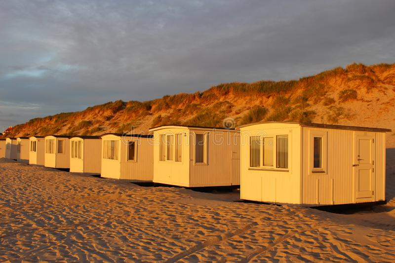 In Denmark, Northern Europe. Bath houses on the beach of Lokken in evening mood stock photography