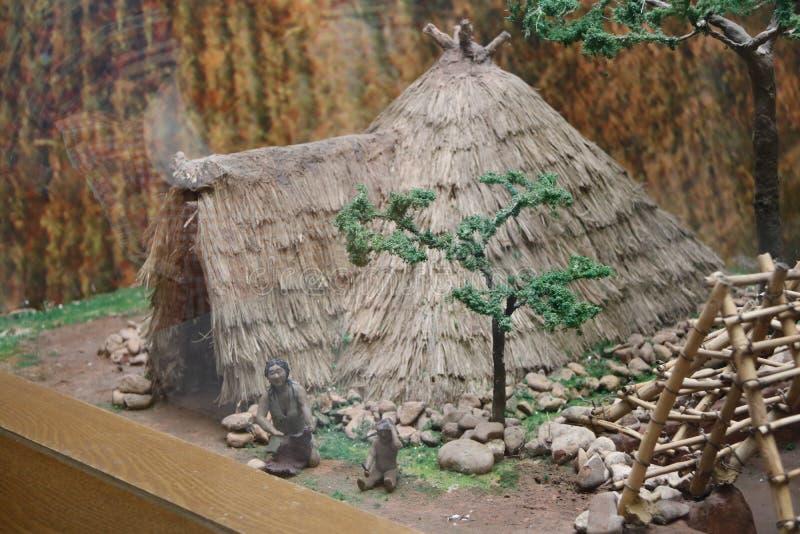 Denna är en kopia av den original- man'sbyggnaden i museet för Hongshan kultur i Kina arkivfoto
