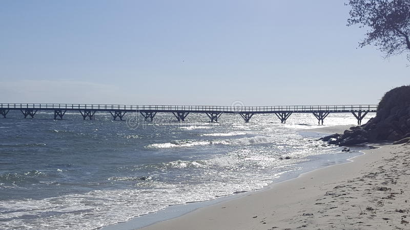 Denny wybrzeże tęsk most obraz royalty free
