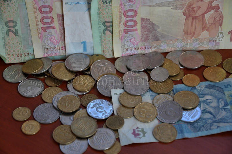 The denominations Ukrainian change and circulating coins and ban. Knotes, which are used as a tool of monetary and payments royalty free stock photo