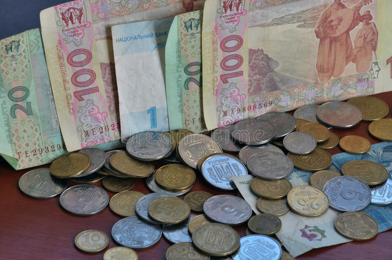 The denominations Ukrainian change and circulating coins and ban. Knotes, which are used as a tool of monetary and payments royalty free stock photos
