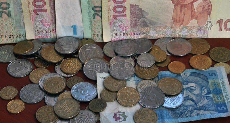 The denominations Ukrainian change and circulating coins and ban. Knotes, which are used as a tool of monetary and payments royalty free stock image