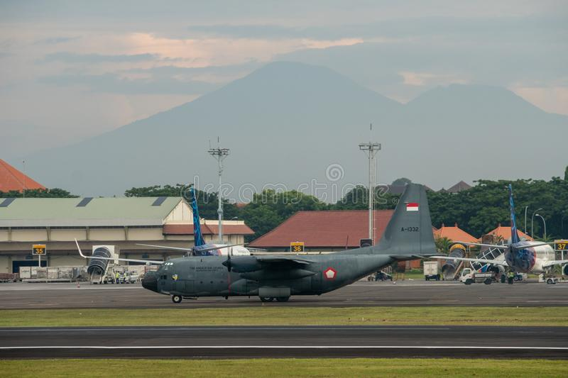DENPASAR/BALI-APRIL 16 2019: Indonesian air force military aircraft are preparing to take off at the international airport Ngurah royalty free stock image