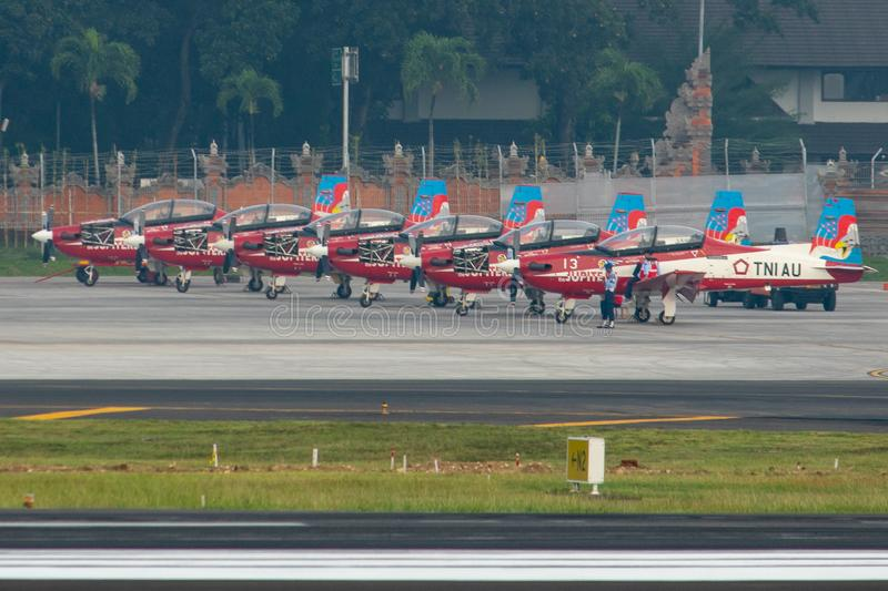DENPASAR/BALI-APRIL 16 2019: seven Jupiter team aircraft belonging to the Indonesian air force are being parked at the apron of stock photography