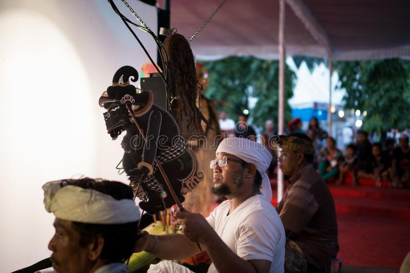 DENPASAR/BALI-DECEMBER 29 2017: Wayang kulit is Indonesian Culture Called Shadow Puppets. It is played by people who called Dalang stock photo
