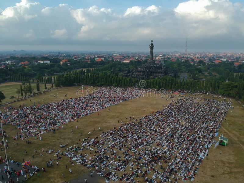 DENPASAR, BALI/INDONESIA-JUNE 05 2019: The view from the air of the Eid al-Fitr prayer in 2019 at Puputan Renon field. Eid prayers royalty free stock photography