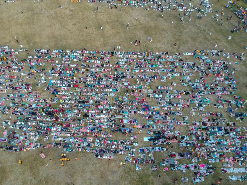 DENPASAR, BALI/INDONESIA-JUNE 05 2019: The view from the air of the Eid al-Fitr prayer in 2019 at Puputan Renon field. Eid prayers stock image