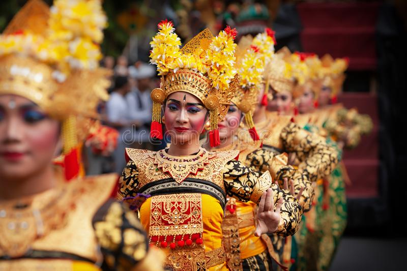 Traditional Balinese dance Legong. DENPASAR, BALI ISLAND, INDONESIA - JUNE 23, 2018: Face portrait of beautiful young Balinese women in ethnic dancer costume royalty free stock image