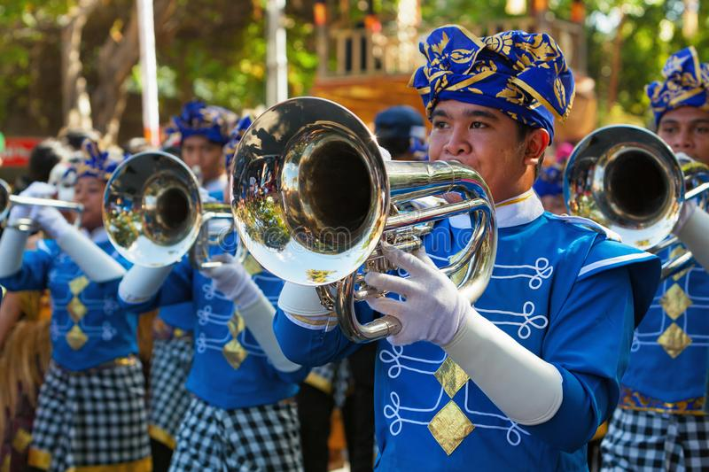 Balinese people play music in Balinese brass band stock images