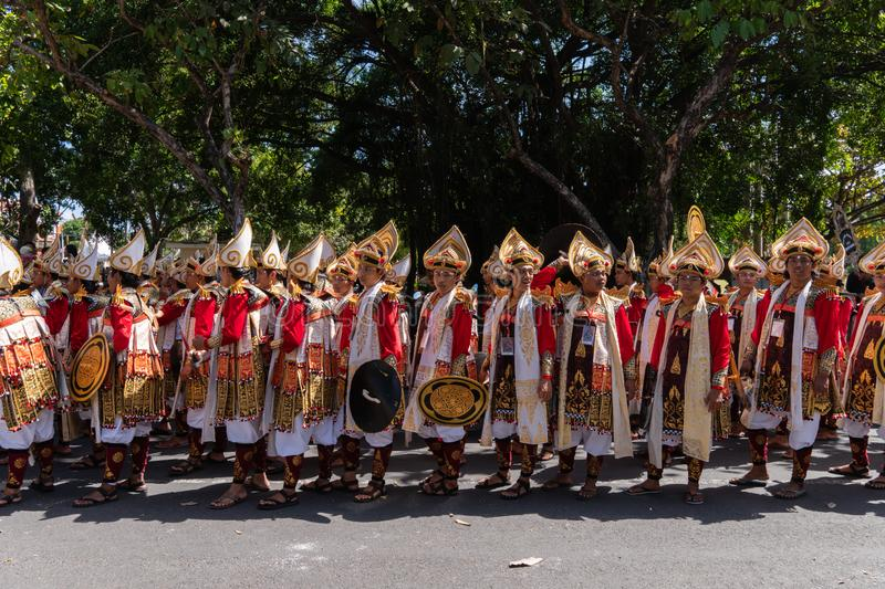 DENPASAR/BALI-JUNE 15 2019: Baris Gede dancers are lining up preparing for the show at the opening ceremony of the Bali Arts royalty free stock photography