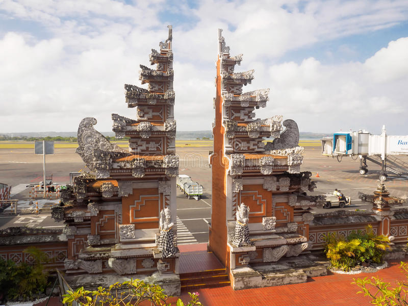 Denpasar International Airport, Bali, Indonesia. Bali, Indonesia - September 18, 2016: The Balinese traditional gate from the apron to the arrival terminal of royalty free stock image