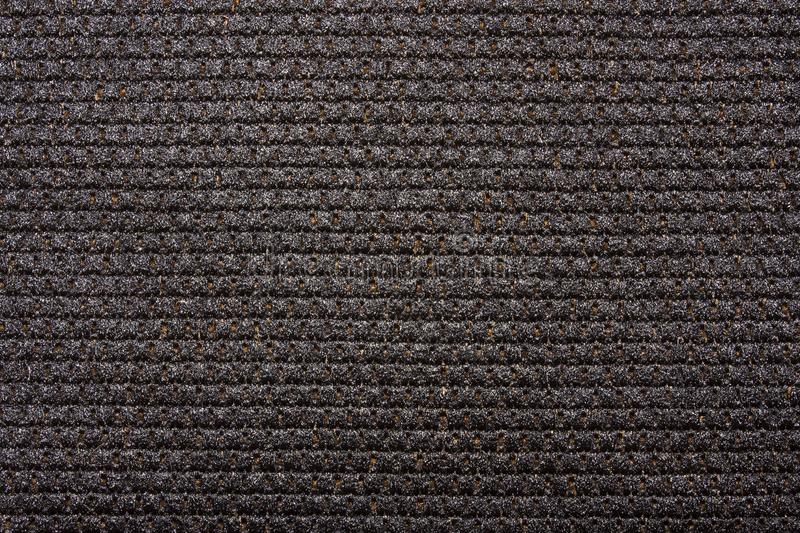 Dense black braided fabric texture. royalty free stock photography