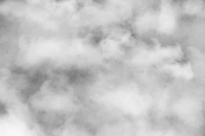Bright White Foggy Clouds Sky. Dense bright white foggy storm cloud cover daytime sky stock image