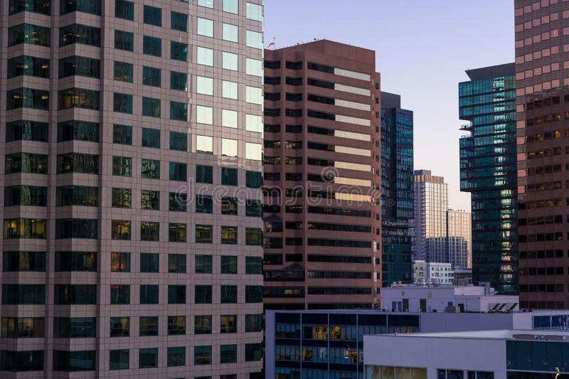 Dense cityscape of modern skyscrapers and high-rise office and residential buildings at sunset stock photography