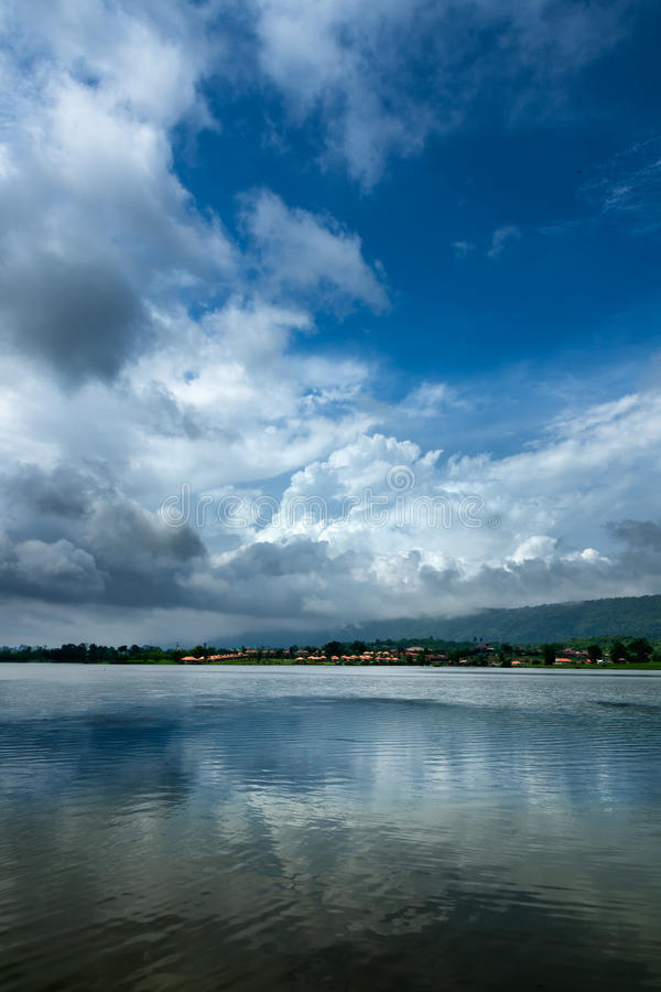Dense cloud in the sky. And the reflection on the water stock photos