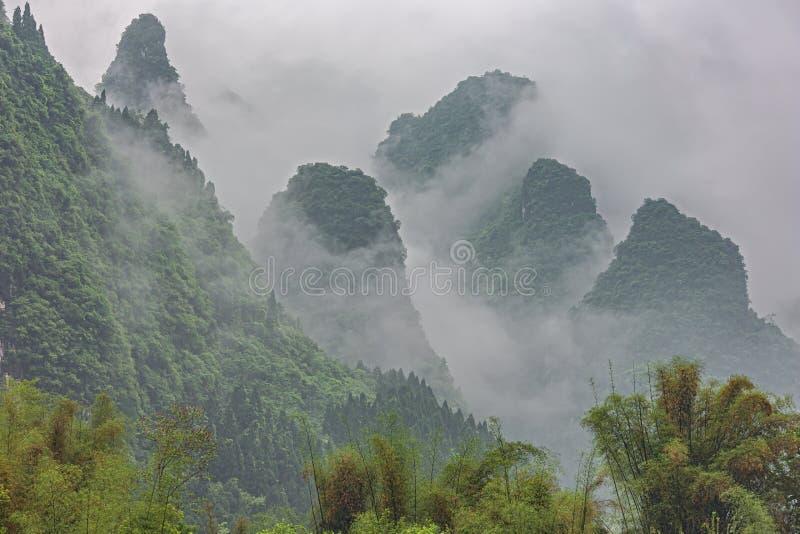 Dense clouds rising along the hills near Yangshuo. On the Li River near Guilin stock photo