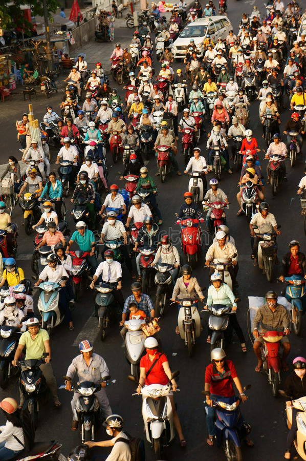 Dense, crowed traffic, motorcycle, Ho Chi Minh. HO CHI MINH CITY, VIET NAM- MAR 27: Dense, crowed scene of urban traffic in rush hour, crowd of people wear stock image