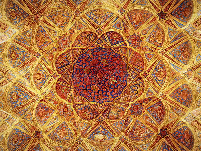 Dense decorations on top floor of Ali Qappu palace of Isfahan. Ceiling of the music room on the top floor of the Ali Qappu palace of Isfahan royalty free stock images