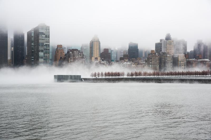 A dense fog covered New York City during the winter`s day on January of 2018. stock image