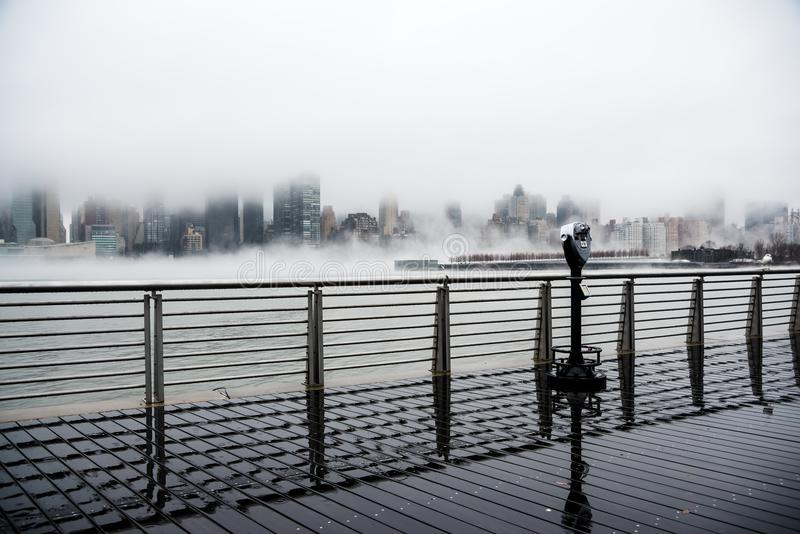 A dense fog covered New York City during the winter`s day on January of 2018 royalty free stock image