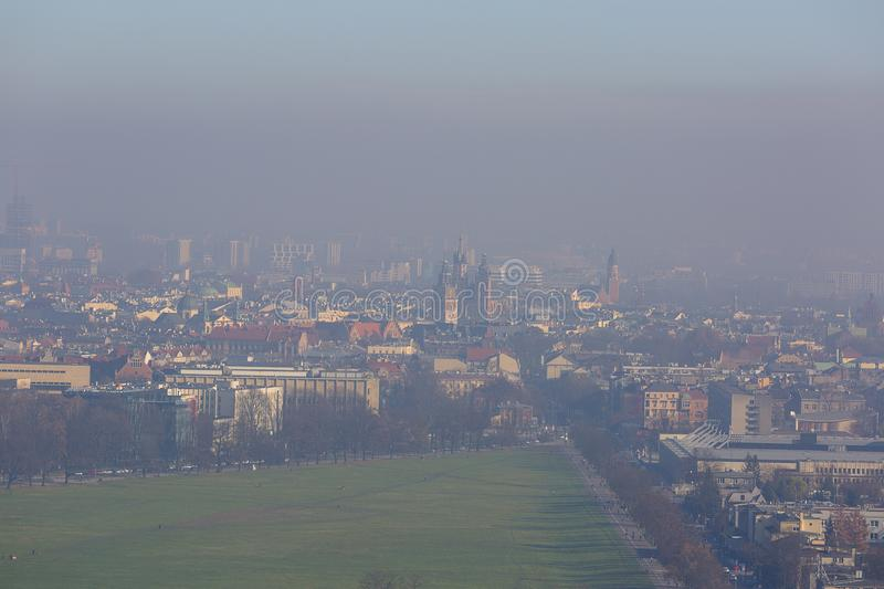 Dense smog over the city, air pollutant, aerial view of the old town Krakow, Poland. stock photos