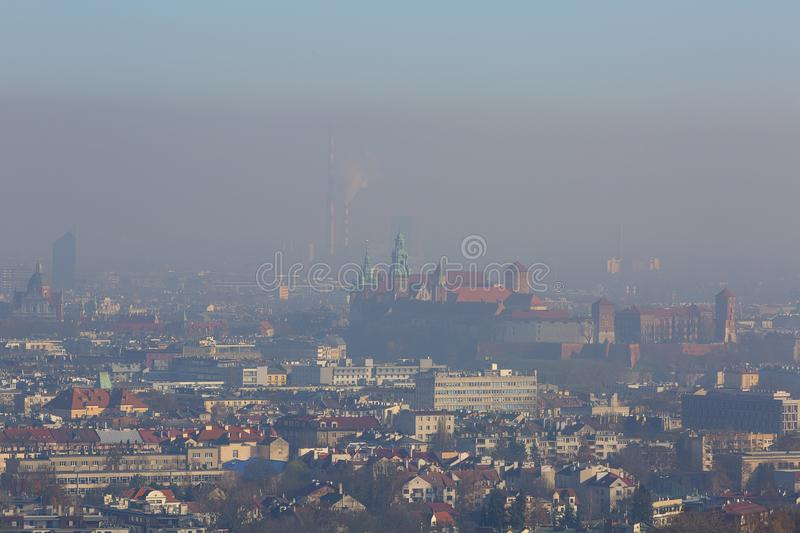 Dense smog over the city, air pollutant, aerial view of the old town Krakow, Wawel Castle, Poland. royalty free stock photos
